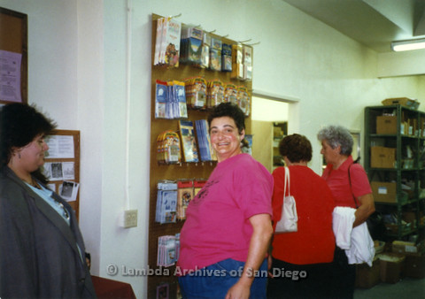 P169.045m.r.t Paradigm Women's Bookstore Grand Opening: Woman in pink standing in bookstore