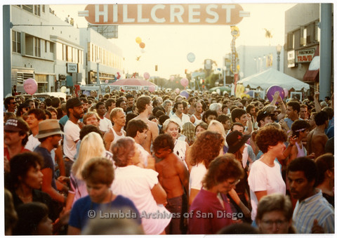 "P201.005m.r.t Hillcrest Street Fair: Long shot of crowd of attendees below ""Hillcrest"" sign (later became CityFest)"