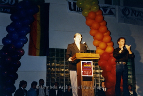 San Diego LGBTQ Pride Rally, July 1997: Christine Kehoe (left) speaking at Rally podium with sign language interpreter (right)