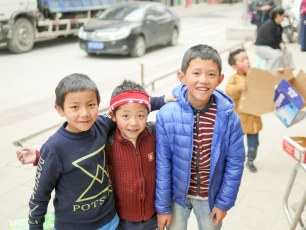 First day off in Dege - these kids stopped jumping around in boxes to demand a portrait.