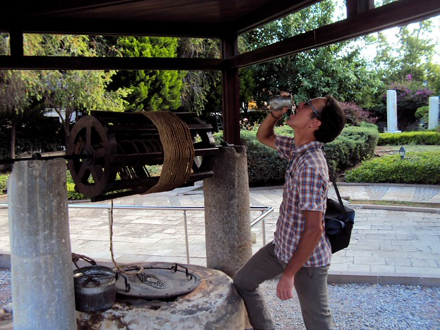 Drinking the holy water from St. Paul's Well; it must have worked as I haven't been sick yet. by bryandkeith on flickr