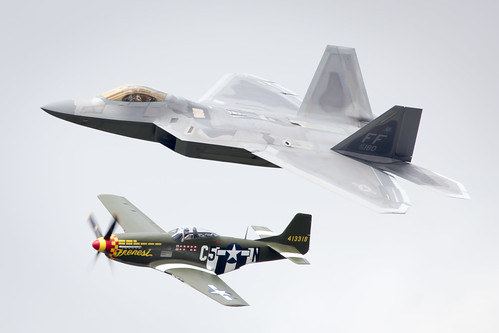 Lockheed Martin F-22 Raptor and P-51 Mustang Heritage Flight performing at Fairford International Air Tattoo 2017