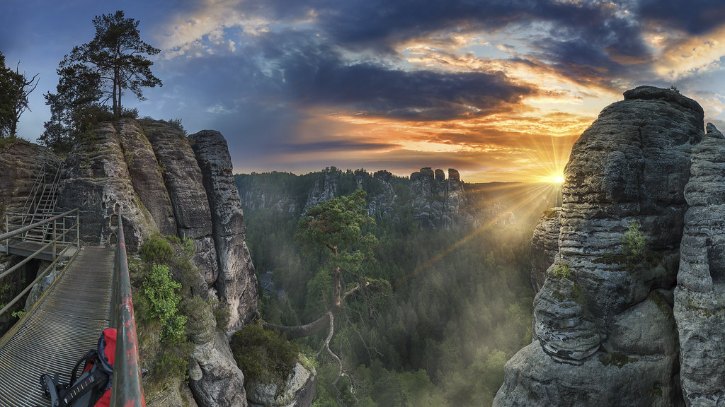 Hiking in morning hours in Elbe Sandstone Mountains