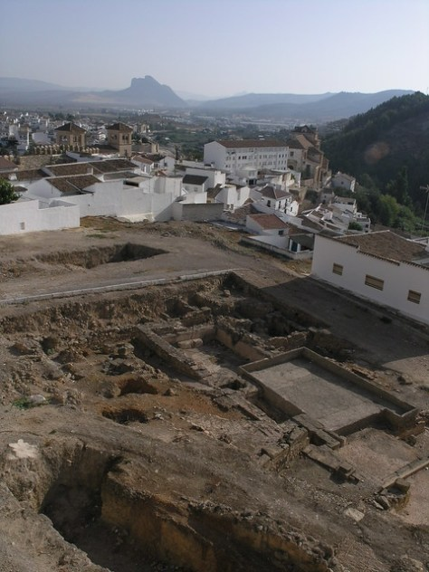 Antequera roman bath ruins with city beyond