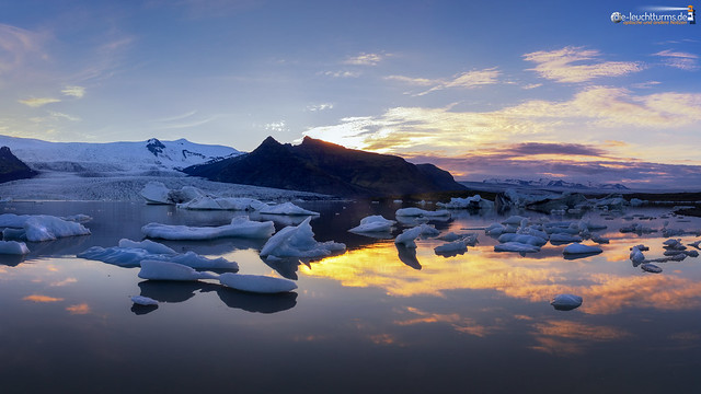 The sun goes down behind the glacier