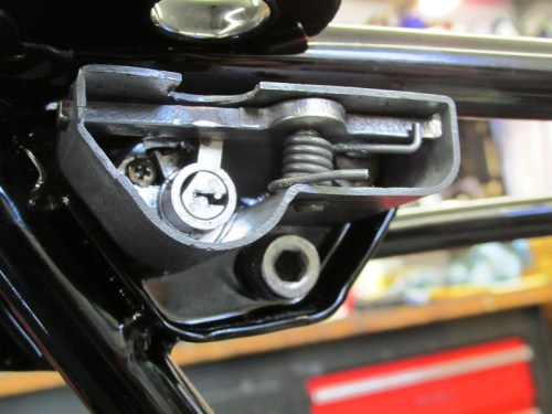 Seat Latch Mechanism Fits Around Lock on Sub-Frame