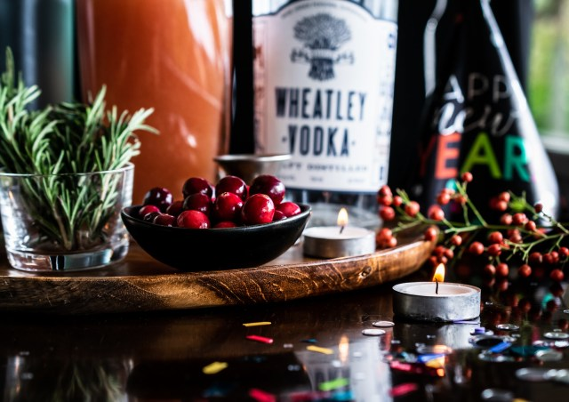 cranberries and rosemary are the perfect holiday cocktail garnish