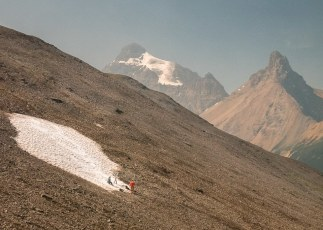 Skiers On Snow Patch