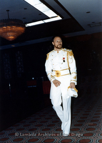 1983 - Imperial Court de San Diego Coronation Ball: Falcon Emperor XI Craig Morgan walking across the ballroom during the Court Processional Introductions.