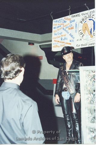 P001.311m.r.t Date Auction: Mr. San Diego Leather onstage, man in black shirt facing him