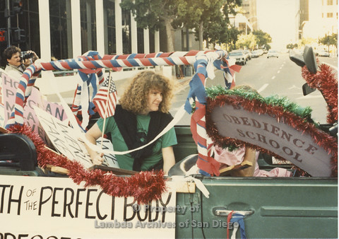 P024.109m.r.t Myth California Protest, San Diego, June 1986: people in a green vehicle