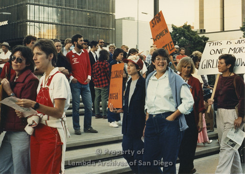P024.107m.r.t Myth California Protest, San Diego, June 1986: Sheila Shanahan and another woman holding an orange sign