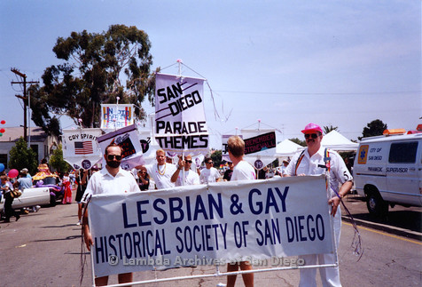 P018.117m.r.t San Diego Pride Parade 1994: David Wasserman (left) and Doug Moore (right) holding main Lesbian and Gay Historical Society banner