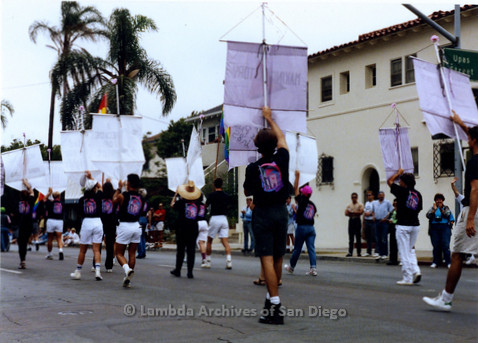 P018.052m.r.t San Diego Pride Parade 1990: Lesbian and Gay Archives walkers with banners