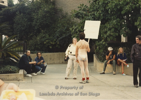 P024.117m.r.t Myth California Protest, San Diego, June 1986: man in center wearing a bunny outfit holding a sign