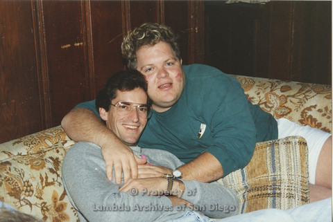 P001.173m.r.t Retreat 1991: 2 men on a couch hugging