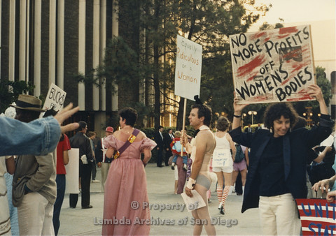 P024.095m.r.t Myth California Protest, San Diego, June 1986: candid shot, woman on the right holding a sign (No More Profits off Women's Bodies)