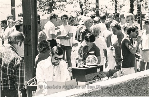 1980 - Rev. David Farrell, (white suit jacket left center) at Metropolitan Community Church Ox Roast. Dick Manning in plaid shirt (far left)