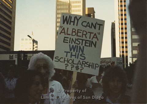 P024.097m.r.t Myth California Protest, San Diego, June 1986: woman in mask holding a sign (Why can't Alberta Einstein win this Scholarship)