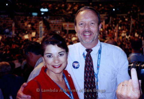 P338.038m.r.t 2000 Democratic National Convention Los Angeles: Charles McKain posing with unknown women in red blazer