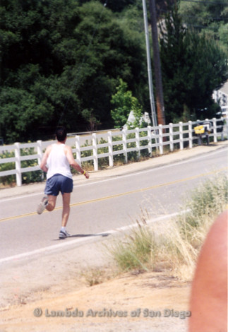 P260.003m.r.t Overland 122 Relay: Man running down road away from camera