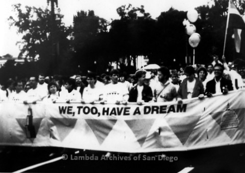 """P019.216m.r.t Second March on Washington 1987: Men and women marching with banner that reads: """"We, Too, Have a Dream"""""""