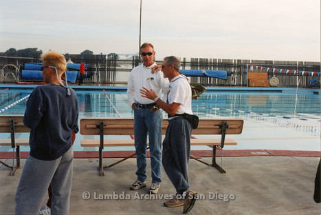 P263.007m.r.t Bart Hopple Memorial Swim: Two men talking in front of the pool
