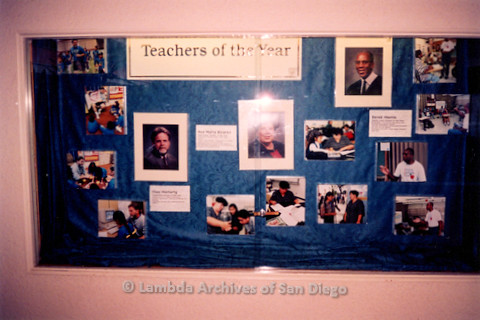 "P122.035m.r.t Displays: Teacher of the Year display, display signs for the three teachers are: ""CHAS MORIARTY,"" ""ANA MARIA ALVAREZ,"" and ""DEREK MORRIS"""