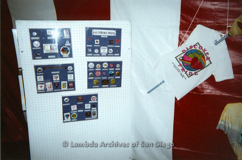 P096.015m.r.t LASD Pride Display: Pride buttons, stickers and patches on display with Discover Pride t-shirt '95