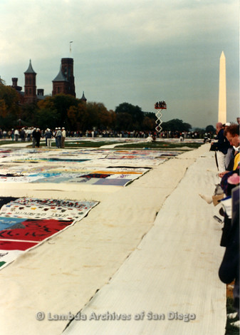 P323.005m.r.t AIDS Quilt at National Mall 1987: Stretch of AIDS quilt display, Washington Monument in the background