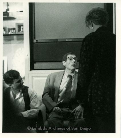 P099.037m.r.t Paul Monette talking to Patricia Nell Warren, Paul's lover Winsten Wilde on the left