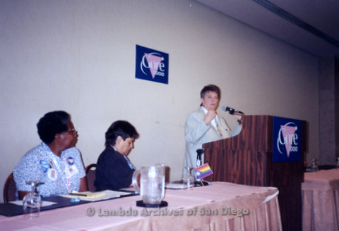 P338.043m.r.t 2000 Democratic National Convention Los Angeles: Woman speaking at podium in front of Gore 2000 sign at the Gay Caucus meeting