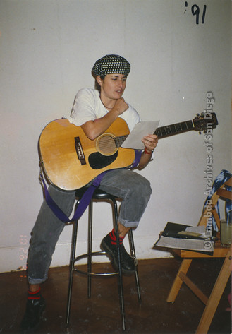 October 26, 1991, San Diego Native, Zanne in Germany: Zanne with her guitar, preparing to Perform for a German Lesbian Audience.