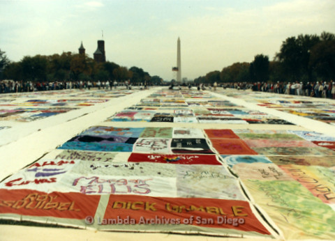 P019.298m.r.t AIDS Memorial Quilt 1987: Large crowd of people looking at the AIDS Memorial Quilt, Washington Memorial (background)