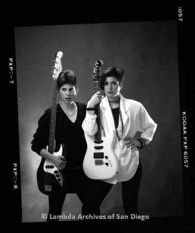 1988 - San Diego Native, Zanne (right) with Bandmate (left) Pose with Their Guitars for a Studio Portrait.