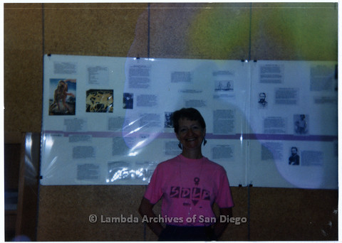 P200.005m.r.t Sharon Parker standing in front of a portion of the TIMELINE at San Diego Public Library