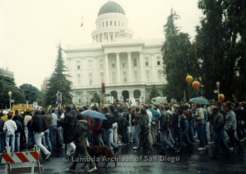 P019.144m.r.t March on Sacramento 1988 / Pre Parade gathering: Crowd of people gathered in front of City Hall