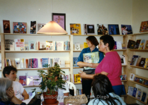 P169.042m.r.t Paradigm Women's Bookstore Grand Opening: Women gathered around table inside bookstore