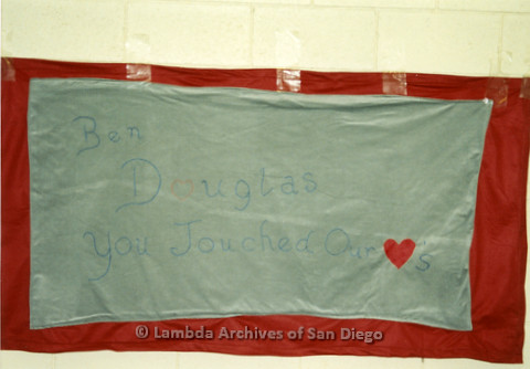 """P019.039m.r.t AIDS Quilt at San Diego Golden Hall 1988: Red and blue quilt saying """"Ben Douglas You Touched our Hearts"""""""