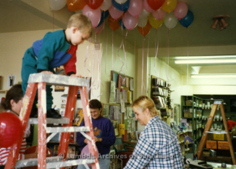 P169.075m.r.t Paradigm Women's Bookstore Grand Opening: Small child on ladder with balloons in background