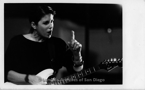 """March 1989 - """"So Many Women"""" Video Shoot: Playing Guitar, Gesturing off Camera."""