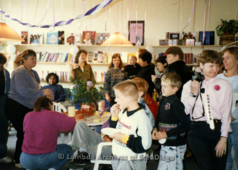 P169.081m.r.t Paradigm Women's Bookstore Grand Opening: Large group of people gathered in bookstore eating and talking