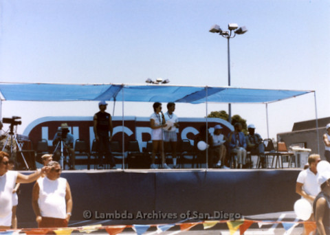 San Diego Lambda Pride Parade: The Reviewing Stand in the Parking Lot of Thrifty's, at the Corner of Fifth and Robinson Avenue in Hillcrest.