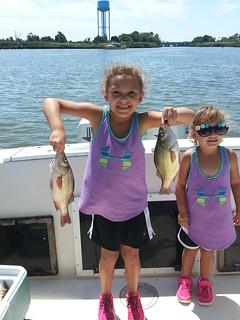 Photo of two girls fishing
