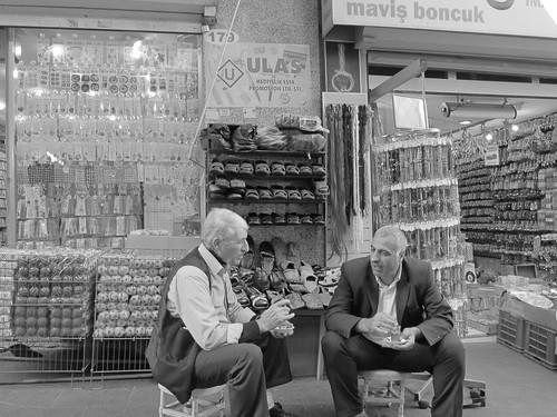 Shopkeepers having tea.