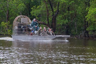 not us, but what we looked like in the backwater, alligator hunting