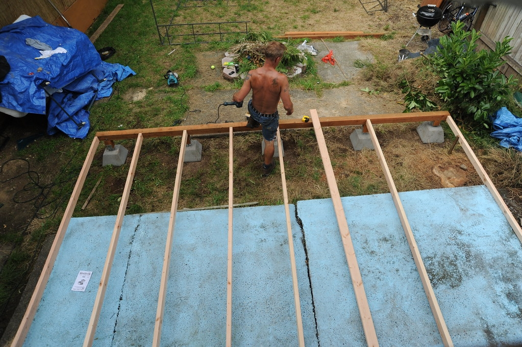 Mike Steps Over The Edge While Building A Deck To Cover O… Flickr   Building Wood Steps Over Concrete   Stoop   Existing Concrete Porch   Concrete Slab   Front Porch   Composite Decking