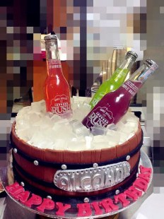 bottle in bucket birthday cake