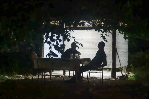 Camping each night in open air restaurants at the side of the road