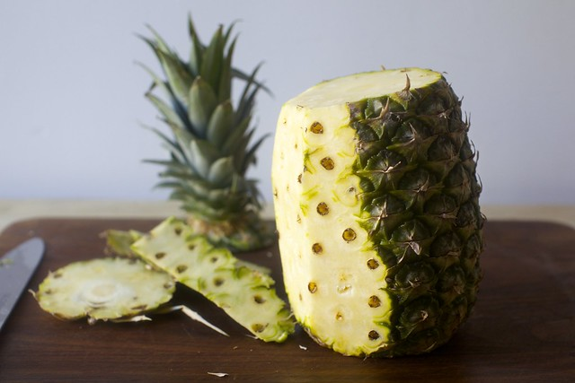 peeling a pineapple